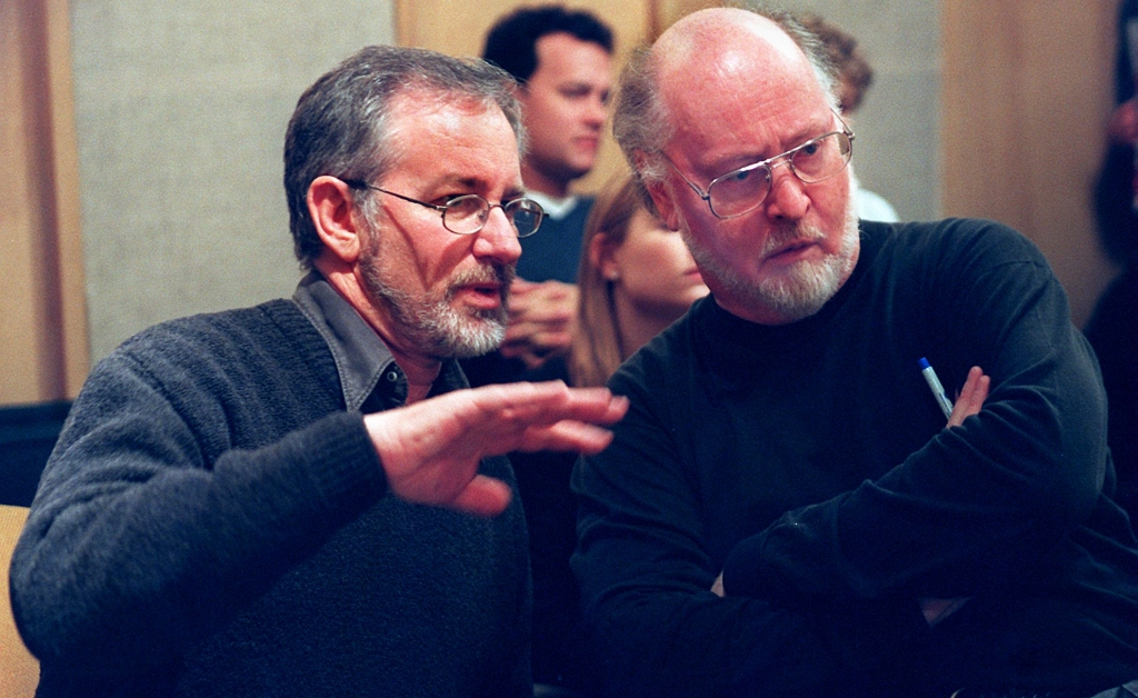BOSTON - FEBRUARY 21: Steven Spielberg and John Williams confer during a break in rehearsal at Symphony Hall. Tom Hanks stands in back. (Photo by Wendy Maeda/The Boston Globe via Getty Images)